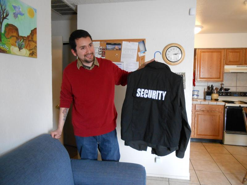 Sergio Cortes bought a security guard uniform, and wears it to patrol his apartment complex.