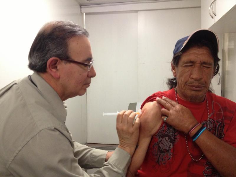 Dr. Salvador Sandoval, left, gives Nick Arellano a cortisone shot.