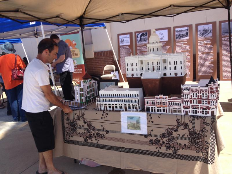 John Rupe displays his buildings at the Fresno Mini Maker Faire at Chukchansi Park