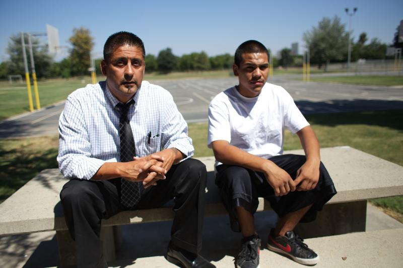 Manny Castro, left, encourages Geronimo Garcia, right, to pursue a life beyond gangs and drugs.