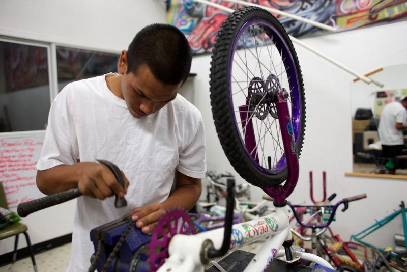 Geronimo Garcia fixes bicycles at the Wittman Village Community Center in Visalia.
