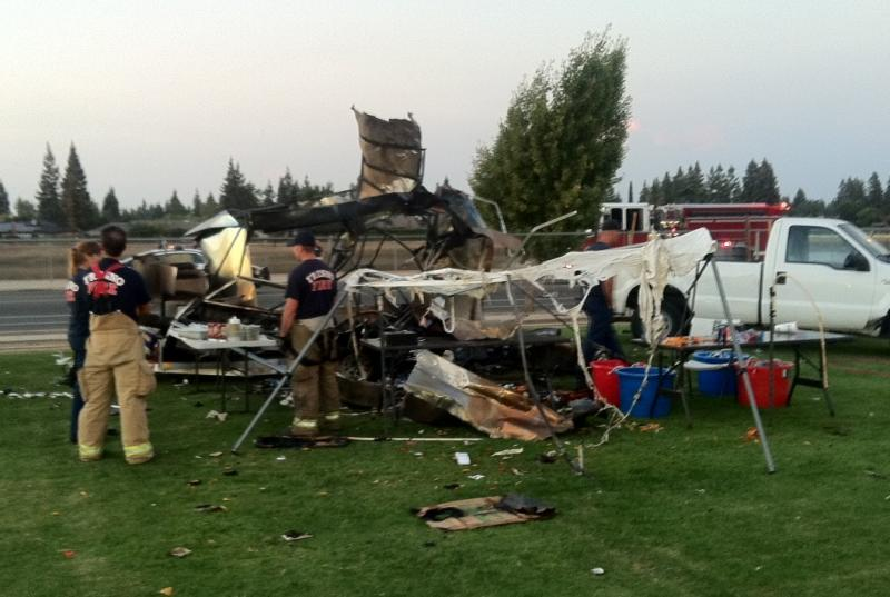 Twisted metal is all that's left of a vendor's food trailer after a fire and explosion on Friday night on the campus of Fresno Christian High School