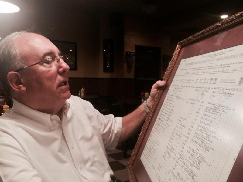 Gary Lanfranco's father came to Fresno just after the turn of the century. Here he looks at his father's immigration documents.