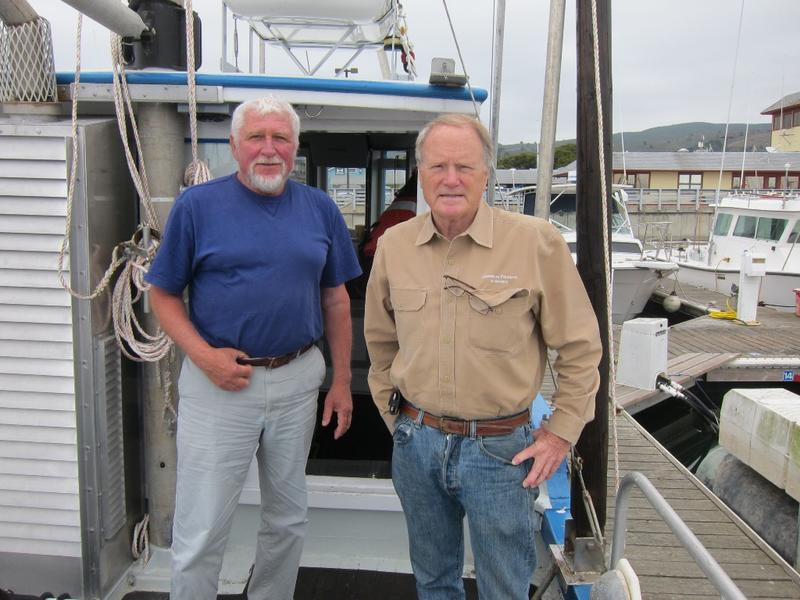 "Former salmon fisherman Pietro Parravano, left, and Zeke Grader, right, of Pacific Coast Federation of Fishermen's Associations on Parravano's boat the ""Anne B."""