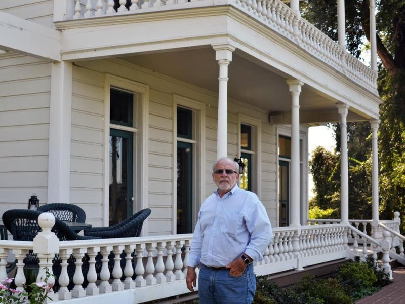 Doug Hemly stands in front of his Courtland home that his great-great-grandfather built.