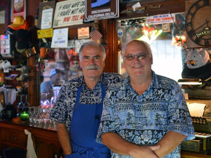 Mark Morais, left, owner of Giusti's and bartender Mark Rogerson, right.