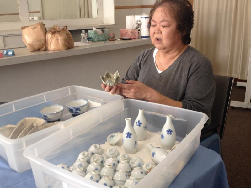 Kathy Omachi examines and collects artifacts from Chinatown.