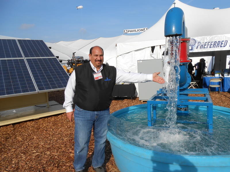 Charles Sarabien with Preffered Pump and Equipment in Fresno shows off a pump run through a solar panel.
