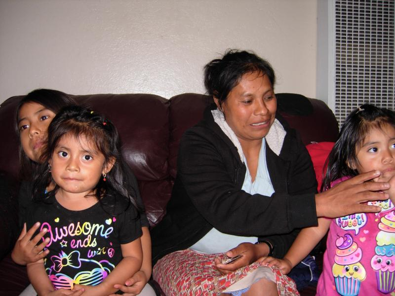 Natividad (center) is a farm worker and indigent care patient who struggles to take care of her diabetes and high blood pressure. Her family shares a home with three other families in Fresno, CA.