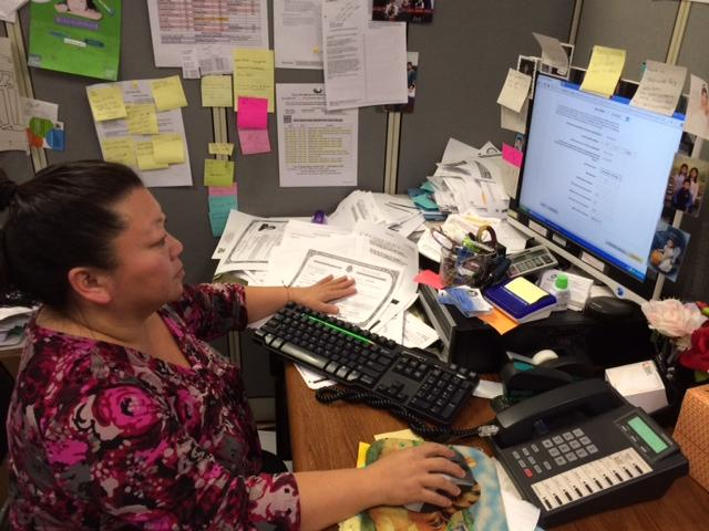 Neng Yang, a certified enrollment counselor at Fresno Center for New Americans, helps people enroll in Medi-Cal.