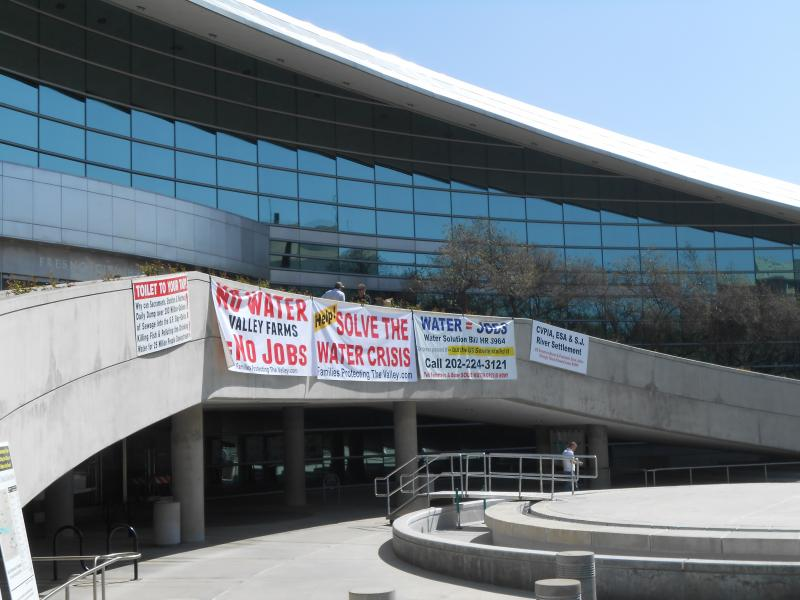 Banners protesting water cuts to local farmers hang outside Fresno City Hall