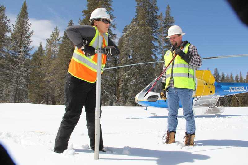 Christine Bohrman measures at 10 different spots at Statum Meadow.