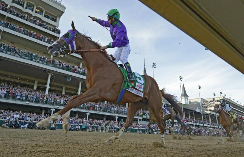 Jockey Victor Espinoza rides California Chrome to a victory during the 140th running of the Kentucky Derby.