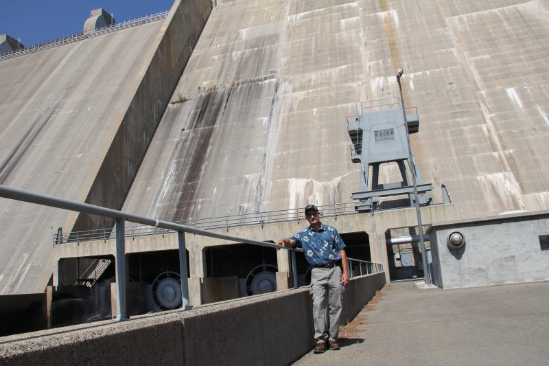 Nick Zaninovich is the chief of operations at Friant Dam. The sturcutre behind him is made up of just under a billion pounds of cement.