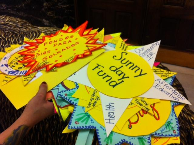"""Sunny Day Fund"" signs that protesters brought to the Capitol for Gov. Brown."
