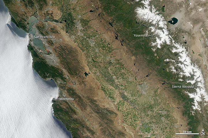 July 2011: In 2011, California was a much greener place as seen in this NASA photo taken July 2, 2011. Note the snowcapped peaks of the Sierra Nevada.