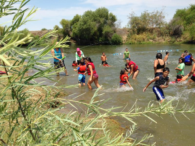 On a 105 degree day, kids play in the San Joaquin River as part of River Camp.
