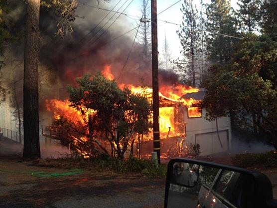A home near Bass Lake is fully engulfed in flames in this photo from the Madera County Sheriff's Office