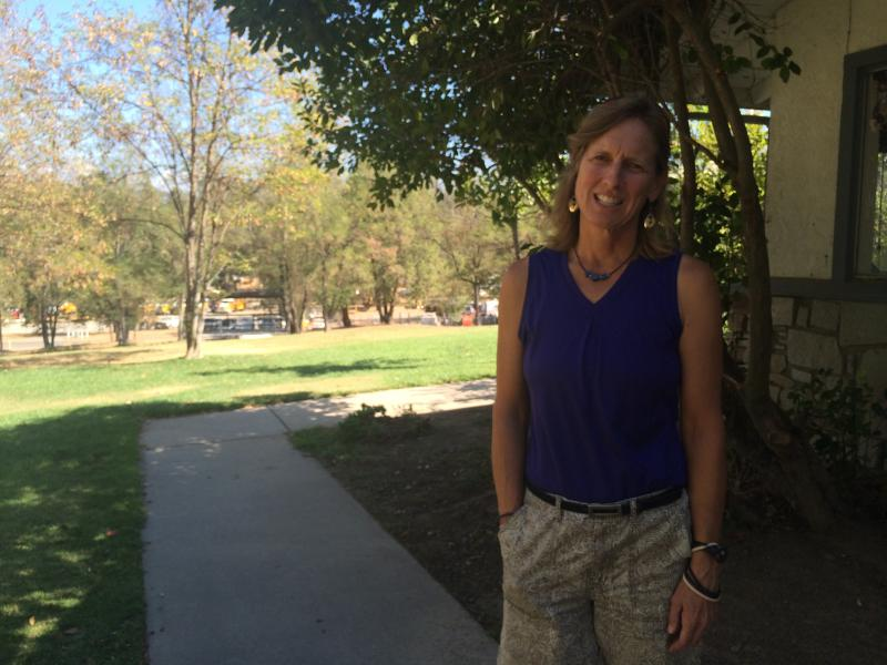 Resident Cherri Mulkey stands outside the evacuation center in Oakhurst.