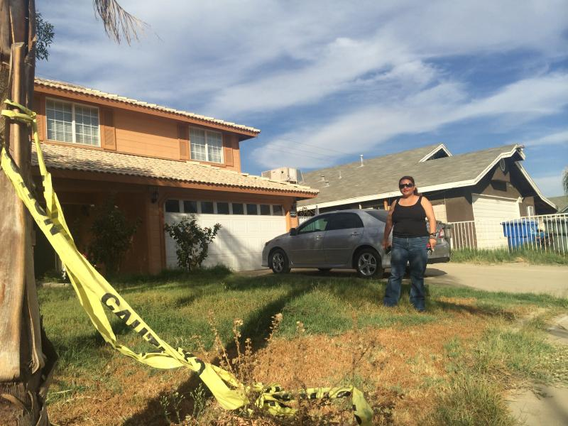 Yesenia Lara stands outside her home on Nelson Court, one of the eight homes evacuated back in March because of a gas leak.