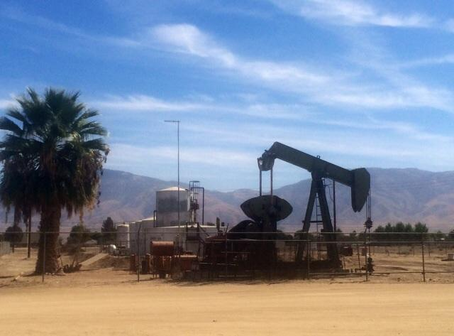 Petro Capital Resources' underground pipeline ran from this oil well carrying field gas to a nearby location where it can be flared off.
