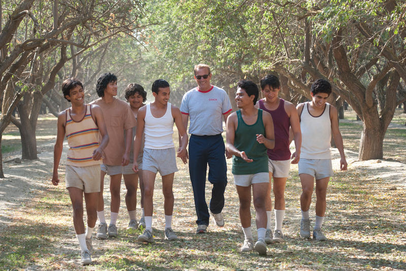"The Disney film ""McFarland, USA"" is a fictionalized story based on the real-life McFarland High School cross country team and their coach Jim White, played here by Kevin Costner."