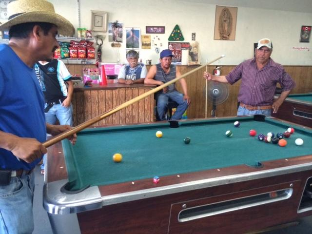 Farmworkers gather at the Westside Pool Hall after a day of work. It's one of the few places where residents can enjoy during their time away from the fields.