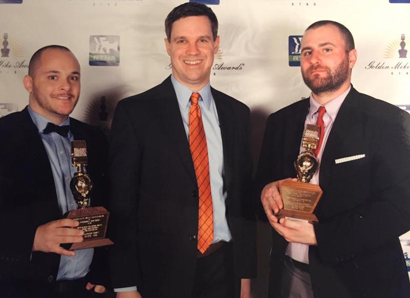 Valley Public Radio's Ezra David Romero, (left); Joe Moore (center) and Jeffrey Hess (right) celebrate the station's Golden Mike Awards