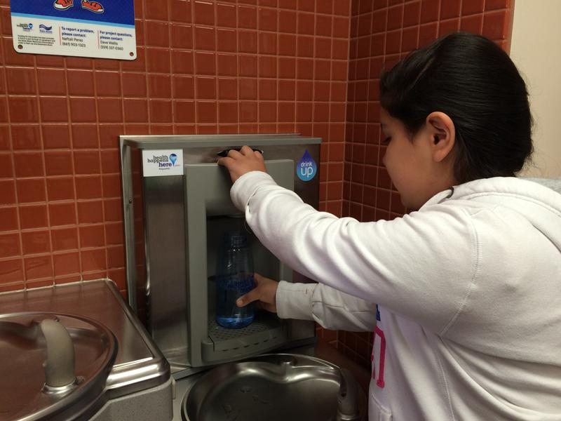 11-year-old Johana Mendoza fills a water bottle at a new filling station installed at El Camino Real Elementary School.
