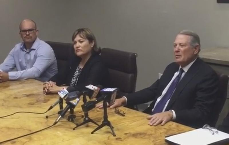 Attorney David Cohn speaks to the media on Thursday flanked by members of the Silva family.