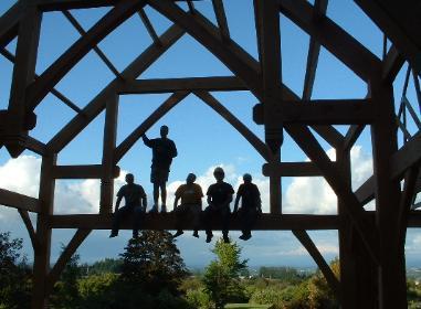 A group workign on building a timber frame.