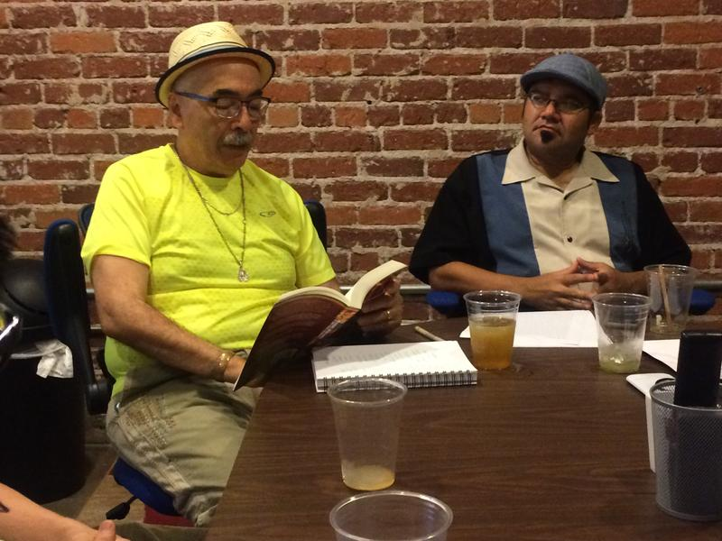 Juan Felipe Herrera reads to a group of Fresno poets.