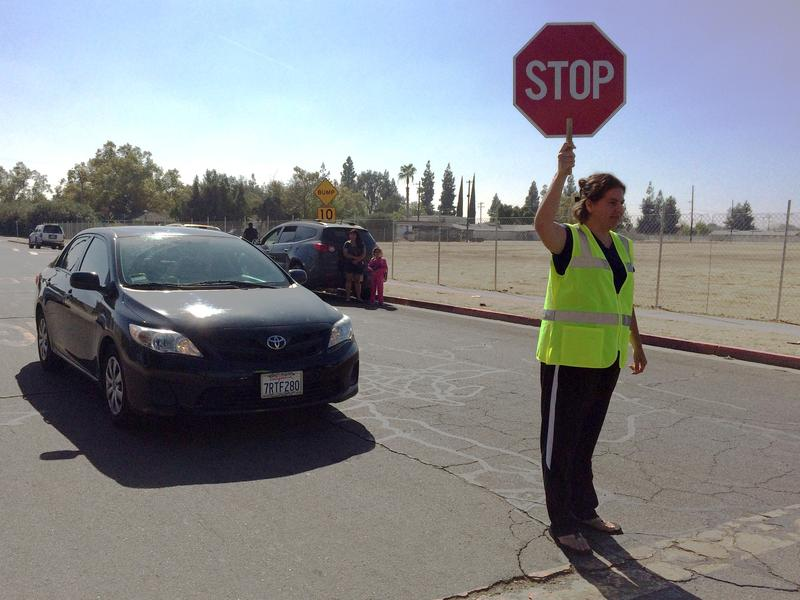 Jessica Zuniga is one of a handful of parents who volunteer every day as a crossing guard near Lane Elementary School.