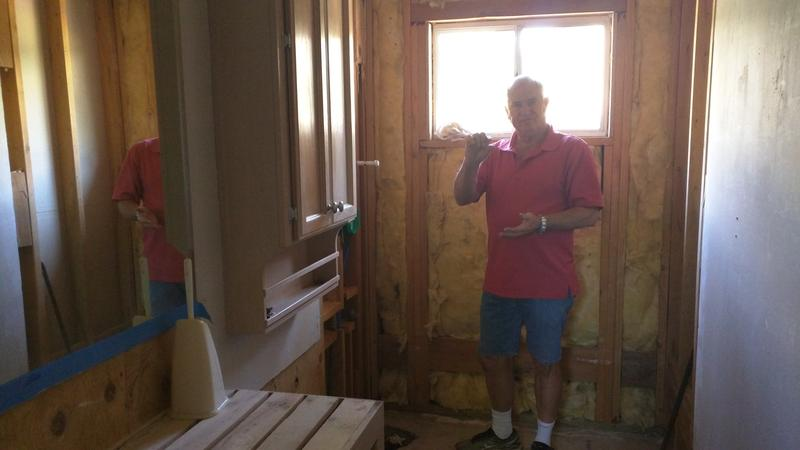 Buzz Nitschke in an under construction bathroom