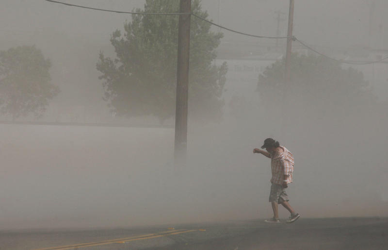 Dust storms, like this one in Fresno, can help distribute the fungal spores that cause valley fever.