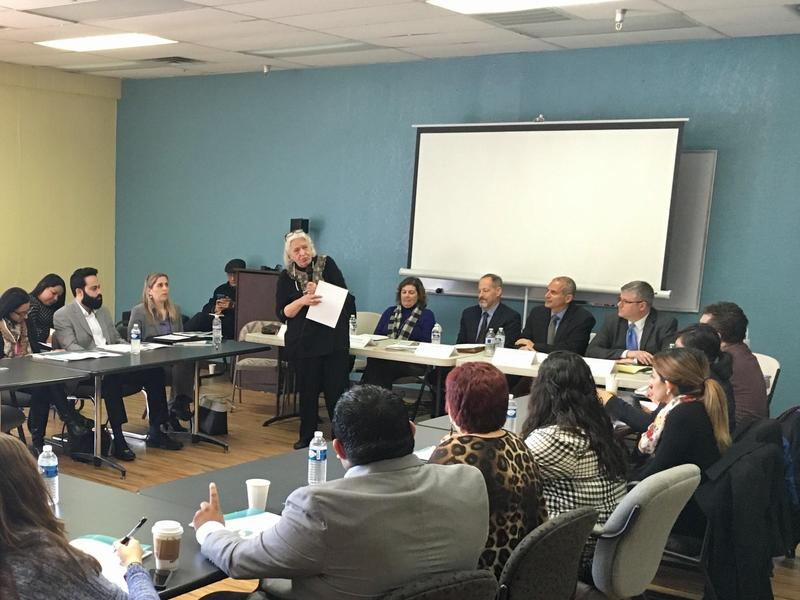 Representatives from local district attorneys' offices and the Federal Trade Commission, at the table on the right, spoke about fraud in Fresno in early January.