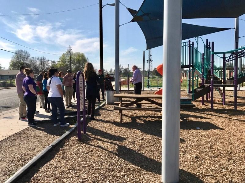 Officials lead a tour of McFarland's new public infrastructure in March 2017, including this park designed by students in 2015 and partially supported by Disney.