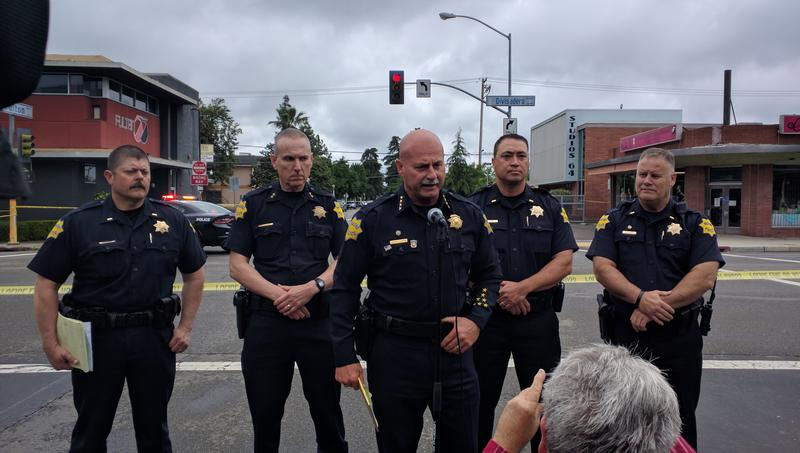 Chief Jerry Dyer(center) briefs the media downtown following Tuesday's shooting spree