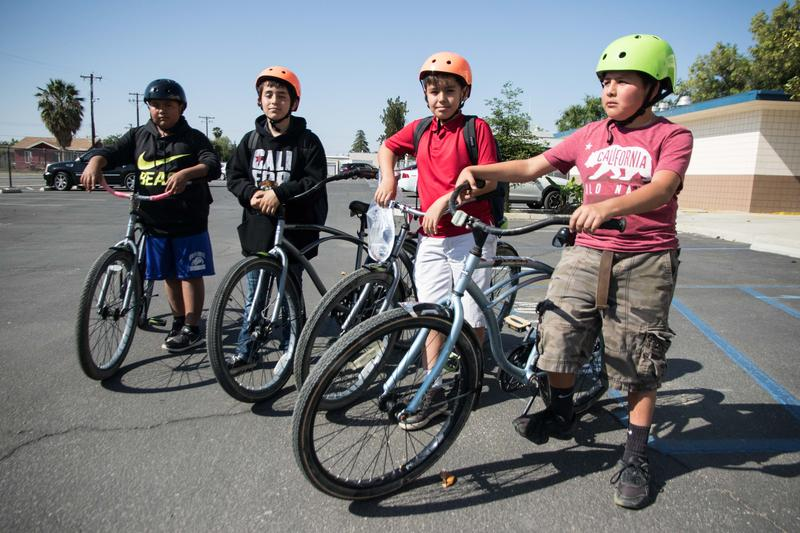 From left to right, Kenny Garcia, Dilan Aguilera, Jorge Rocha and Carlos Rosales are some of the 30 Haven Drive Middle School students who received a new bike in Arvin last week.