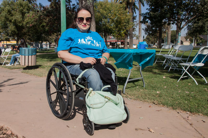 Maria Muñoz is volunteering for the first time at the Walk-N-Roll for Spina Bifida, an annual event in Tulare that aims to raise awareness of the disease and help survivors meet and support each other.