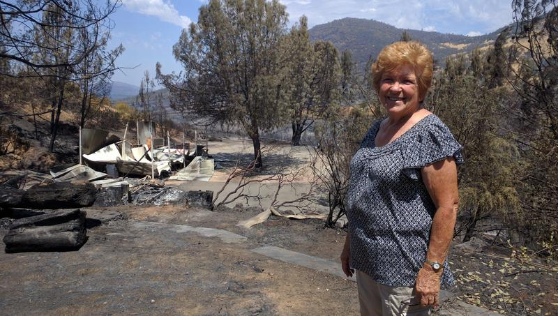 Linda Scoggin looks at her burned out shed