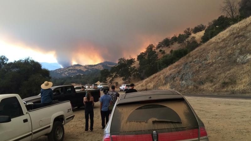 Residents watch as the Detwiler Fire approaches Mariposa Tuesday afternoon.