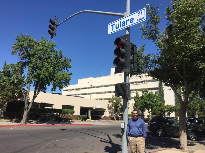 Fresno CIO Bryon Horn stands next to a traffic signal, a potential site for small cells.