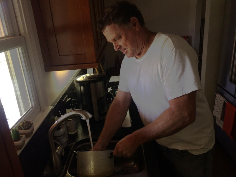The water Keith Prickett is washing his dishes with is polluted with nitrates. A fix is years away.