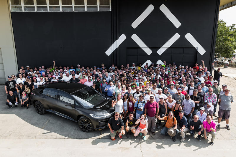 Employees of Faraday Future gather at the company's new facility in Hanford, CA.