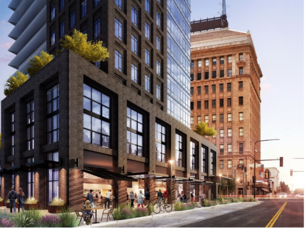 The planned 15-story mixed-use building would have nearly 130 apartment units over retail.