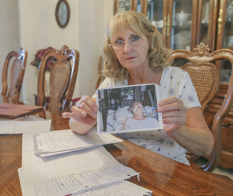 Elizabeth Mulikin holds a photograph of her sister, Edie Preller, at Kaweah Delta Medical Center in Visalia as she battled valley fever. Preller became ill in October of 2005 but was misdiagnosed until two years later. She passed away on May 18, 2008.