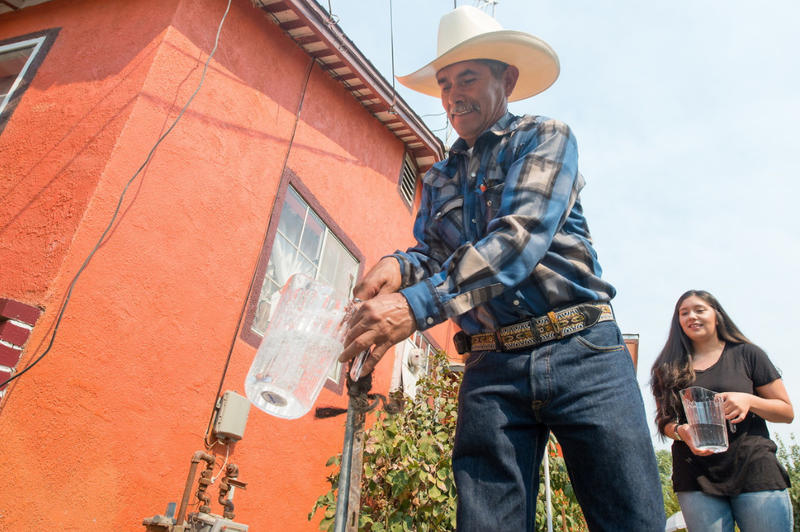 Homeowners Leonicio Ramirez and his daughter Tania Ramirez are the first residents to receive water through a water distribution system in East Porterville, Calif.  on August 19, 2016. (file photo)