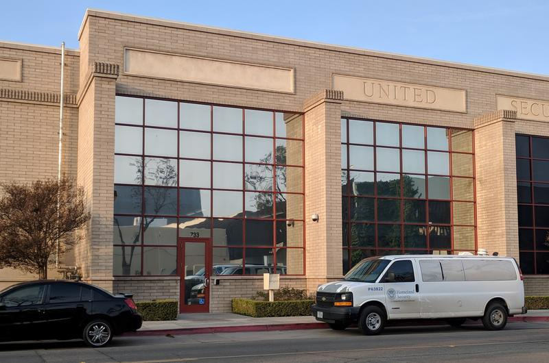A Department of Homeland Security van parks outside this downtown Immigration and Customs Enforcement office, which otherwise bears no sign or information about what's inside.