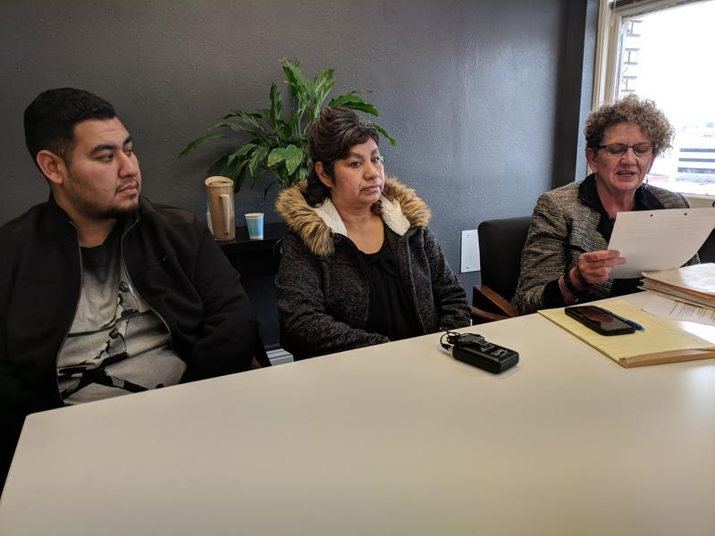 Martha Lozano, center, and her son, Jonathan, listen as her attorney, Camille Cook, reads Lozano's deportation order at Cook's office earlier this week. Lozano's appeal was denied, even though her doctors argue she's in need of medical care in the U.S.